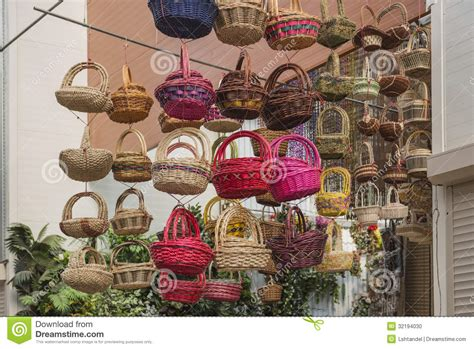 Colorful Baskets At A Flower Shop, Hanging From The