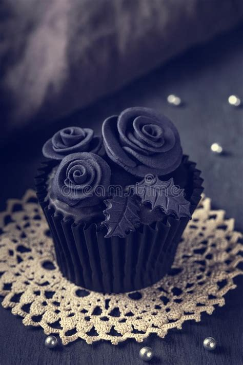 Black Cupcakes On A Wooden Background Stock Photo - Image