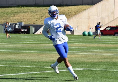 Suspended sophomore David Cormier aids in Air Force